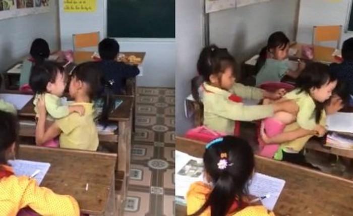Cộng đồng mạng rơi nước mắt trước cảnh bé gái vừa ngồi học vừa trông em nhỏ - ảnh 1