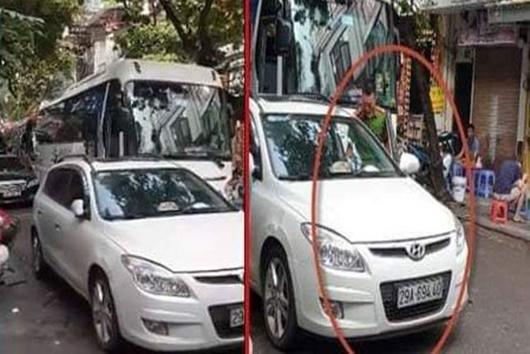 Hà Nội: Trung úy công an đỗ xe giữa đường bị xử phạt - ảnh 1