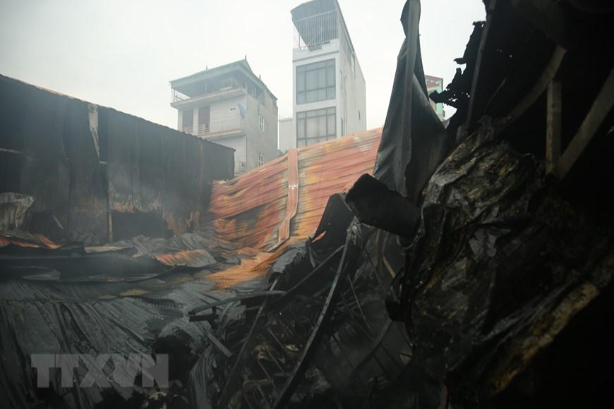 Vụ cháy ở Hà Nội: Xác định có ba mẹ con mất tích trong số 8 nạn nhân - Ảnh 1