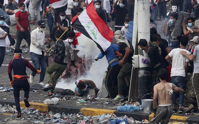 Xả súng đẫm máu vào người biểu tình ở Iraq, ít nhất 18 người thiệt mạng - ảnh 1