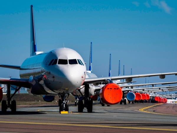 """Cảnh tượng """"não nề"""" chưa từng có với ngành hàng không thế giới: Máy bay """"đắp chiếu"""" hàng loạt  - ảnh 1"""
