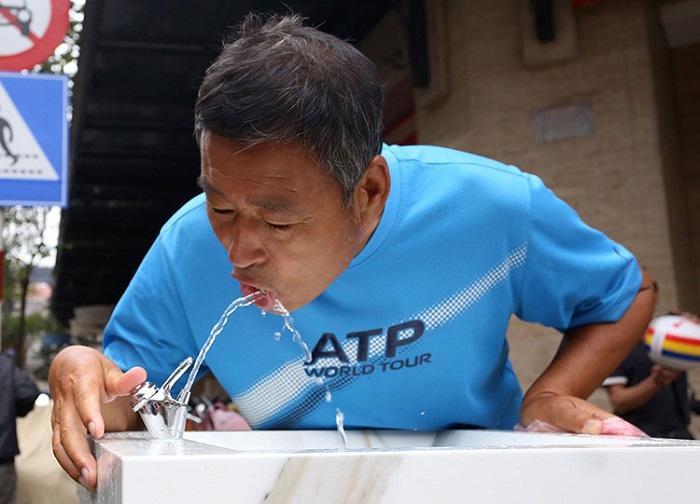 Hà Nội: Người dân hào hứng với trụ nước sạch miễn phí - Ảnh 3
