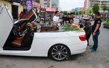 Đại gia gây sốc: Lái BMW mui trần đi bán hành