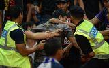 Malaysia bắt giữ 5 người đánh cổ động viên Việt Nam