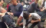 Hình phạt nào cho 2 cha con hành hung thương binh sau va chạm giao thông?