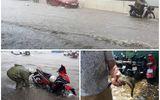 """Xe """"bơi"""" trên quốc lộ 32, người ùa ra đường bắt cá sau trận mưa lớn tại Hà Nội"""
