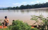 Vượt sông bằng xe bò, 3 người bị nước lũ cuốn mất tích