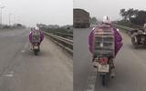 Tin tức - Xôn xao clip trời giá rét mẹ đi xe máy, chở con trai trong lồng chim