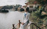 Á hậu Hoàng Thùy diện áo dài khoe dáng ở quê nhà