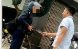 Lái xe cầm dao dọa giết phóng viên khi đang tác nghiệp