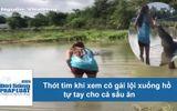Clip: Thót tim khi xem cô gái lội xuống hồ cho cá sấu ăn