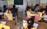 Tin tức - Cộng đồng mạng rơi nước mắt trước cảnh bé gái vừa ngồi học vừa trông em nhỏ