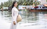 Tin tức - Vẻ duyên dáng trong tà áo dài của Hoa hậu Tiểu Vy ở quê nhà Hội An