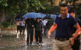 Người dân Hà Nội và các tỉnh đội mưa đến viếng Chủ tịch nước Trần Đại Quang