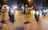 """Tin tức - Video: CSGT vừa làm nhiệm vụ vừa đập tay người đi """"bão"""" ăn mừng chiến thắng"""