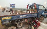 Va chạm với xe tải, một người văng qua lan can cầu Thanh Trì