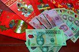 Tin tức - Sao Việt cho con dùng tiền lì xì và cách người Nhật dạy con