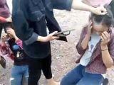 Video - Nhóm nữ sinh dùng dép đánh giữa mặt bạn một cách dã mạn
