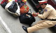 CSGT bắt ôtô khách vận chuyển hơn 100 kg pháo