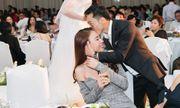Cường Đô la tình tứ hôn Đàm Thu Trang trong tiệc cưới Diệp Lâm Anh