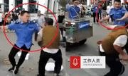 Video: Cán bộ đô thị cầm roi đánh người bán hàng rong dã man tại Trung Quốc