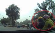 Video: Nữ 'ninja' vượt ẩu, bị kẹp giữa 2 xe tải