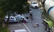 Video: Người phụ nữ thoát chết thần kỳ dưới bánh xe bồn nhờ mũ bảo hiểm
