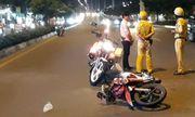 CSGT bị tông, kéo lê hơn chục mét ở Sài Gòn