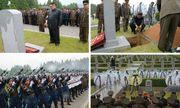 Ông Kim Jong-un đội mưa tham dự lễ tang nguyên soái quân đội