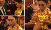 Video: Xôn xao cô dâu trẻ đeo 20kg trang sức vàng trong đám cưới