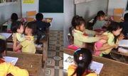 Cộng đồng mạng rơi nước mắt trước cảnh bé gái vừa ngồi học vừa trông em nhỏ