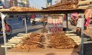 Ngày vía Thần Tài, phố cá lóc nướng Sài Gòn tất bật từ tờ mờ sáng
