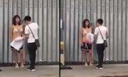 Choáng váng vì cô vợ lột phăng quần áo giữa phố đông người vì cãi nhau với chồng
