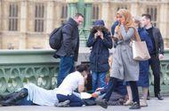 Tin thế giới - Thực hư thông tin người phụ nữ vô tâm cầm điện thoại đi qua nạn nhân vụ khủng bố
