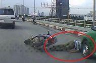 Video-Hot - Video: Xe máy ngã văng trước đầu taxi, tài xế thoát chết ngoạn mục