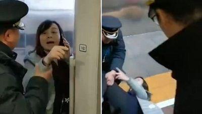 Nữ giáo viên chặn cửa tàu cao tốc vì ...chồng - ảnh 1