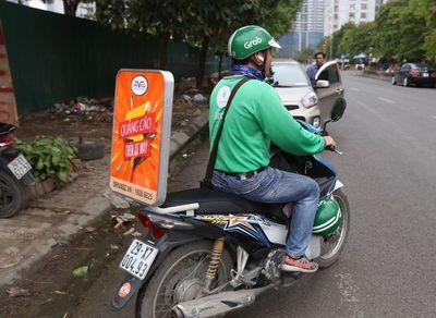 Quảng cáo trên xe máy có phải xin giấy phép?  - ảnh 1