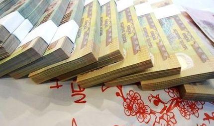 """Tin tức - Đổi tiền lẻ, tiền mới tại chợ đen bị hét giá """"cắt cổ"""""""