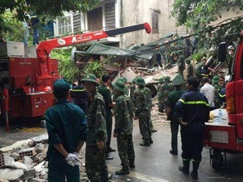 Hiện trường vụ sập nhà, vùi lấp 4 người tại Hà Nội - Ảnh 8