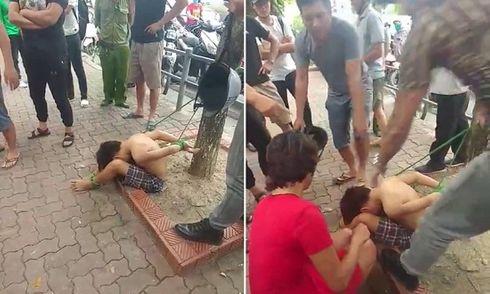 Vụ cậu bé đánh giày bị trói vào gốc cây: Tạm giữ 3 nghi phạm