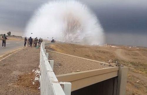 Hàng loạt vụ nổ bom liên tục diễn ra tại iraq - Ảnh 2