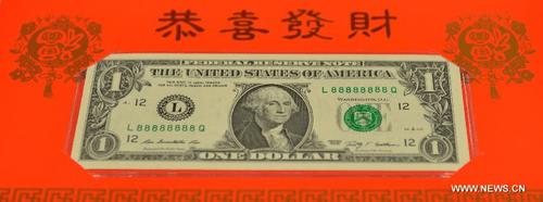 """Mỹ phát hành 88.888 tờ """"Tiền may mắn năm con Dê"""" mệnh giá 1 USD - Ảnh 1"""