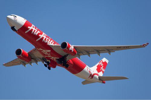 Hé lộ danh tính ông chủ hãng hàng không AirAsia - Ảnh 1