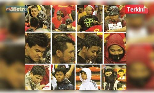Malaysia công bố ảnh, truy tìm 12 kẻ tấn công CĐV Việt Nam - Ảnh 1
