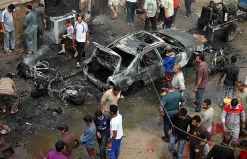 Đánh bom vào dòng người hành hương ở Iraq, ít nhất 14 người thiệt mạng - Ảnh 1