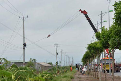 Hoàn thành việc khắc phục sự cố về điện sau bão số 1 - Ảnh 1