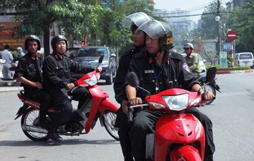 Từ 2/9, Cảnh sát cơ động không được dừng xe vi phạm mũ bảo hiểm - Ảnh 1