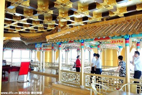 Cận cảnh khách sạn 74 tầng dát vàng ở Trung Quốc - Ảnh 14