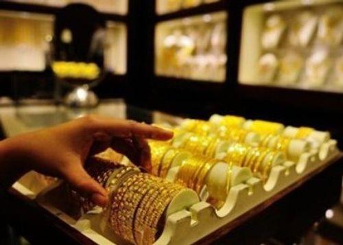 Giá vàng hôm nay 13/7: Giá vàng SJC giảm 550.000 đồng/lượng - Ảnh 1