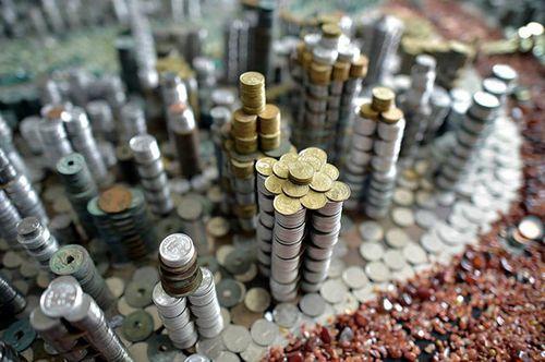 """Người đàn ông dùng 50.000 đồng tiền xu để """"xây"""" thành phố Trùng Khánh - Ảnh 1"""